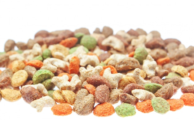 Multicolored food for cats and dogs. on a white wall. Premium Photo