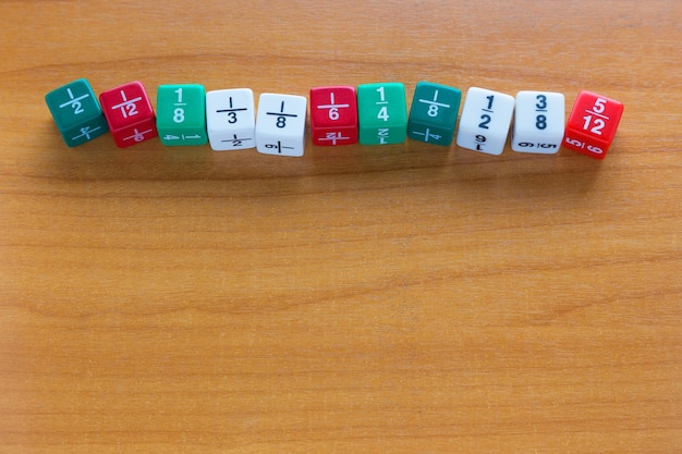 Multicolored fracetion dices Premium Photo