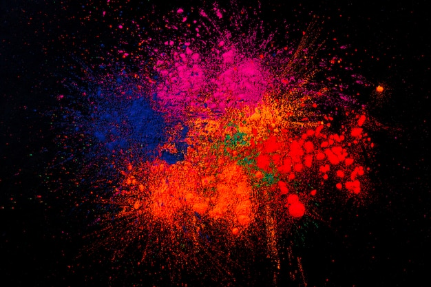 Multicolored holi colors mixed over black background Free Photo