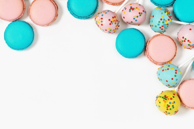 Multicolored macaroons and cake pops close up. sweet dessert for background with copy space. assorted cookies. Premium Photo