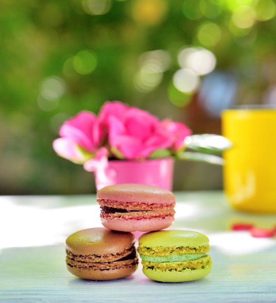 Multicolored macaroons on a white wooden table Premium Photo