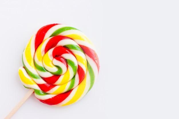 Multicolored round lollipop  with stripes Premium Photo