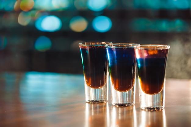 Multicolored shots on bar Premium Photo