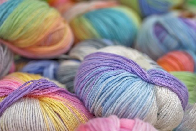 Multicolored wool balls of yarn for embroidery Premium Photo