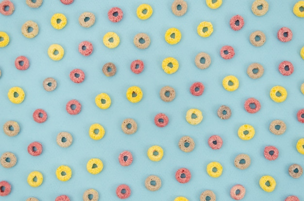 Multicoloured cereals with fruity on blue background Free Photo