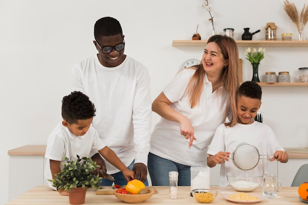 Multicultural family cooking in the kitchen together Free Photo