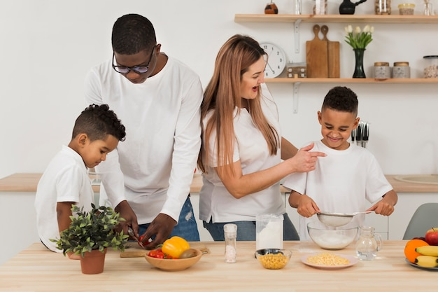 Multicultural family cooking in the kitchen Free Photo