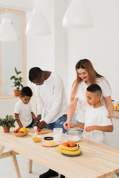 Multicultural family spending time together at the table Free Photo