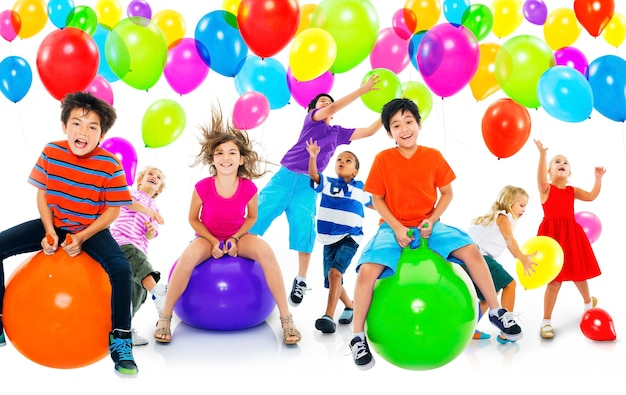 Premium Photo | Multiethnic children balloon happiness friendship concept