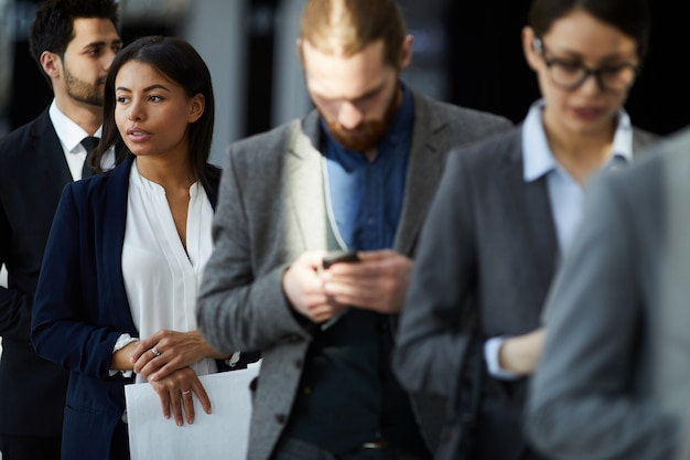 Multiethnic group of business people in line Premium Photo