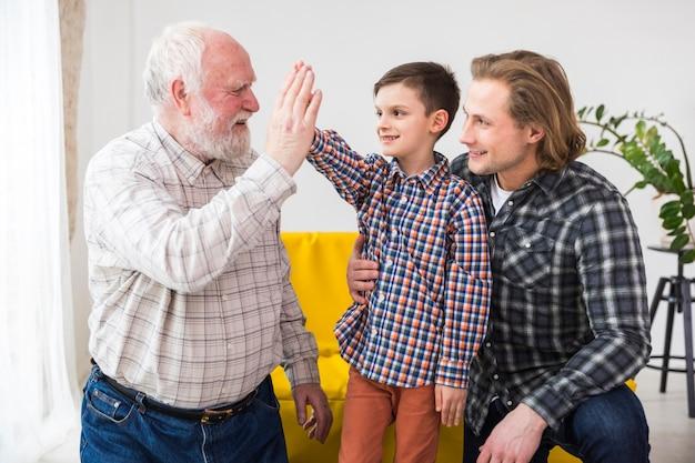 Multigenerational men spending time together Free Photo