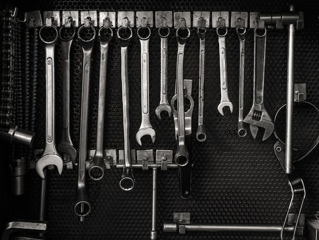 Multiple wrenches hanging on tool board Premium Photo