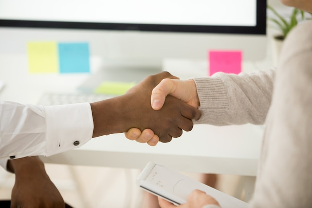 Multiracial business handshake as concept of help support in teamwork Free Photo