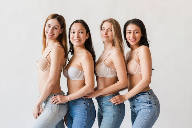 Multiracial group of happy women posing in bras Free Photo
