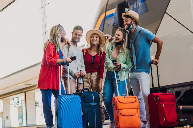 Multiracial group of people walking at train station Premium Photo