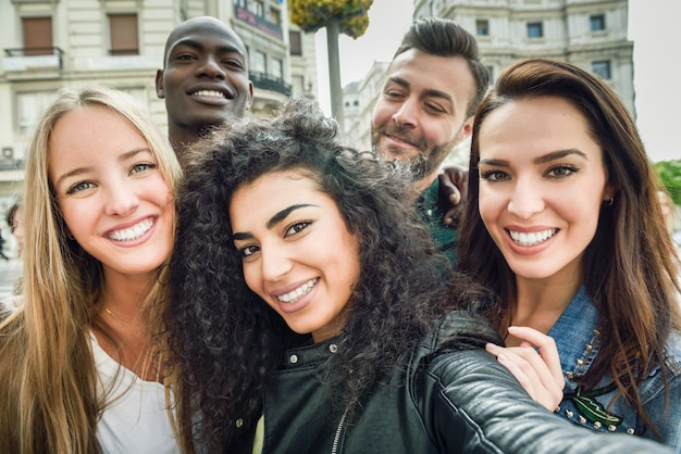0855a60f56846 Multiracial group of young people taking selfie Photo | Free Download