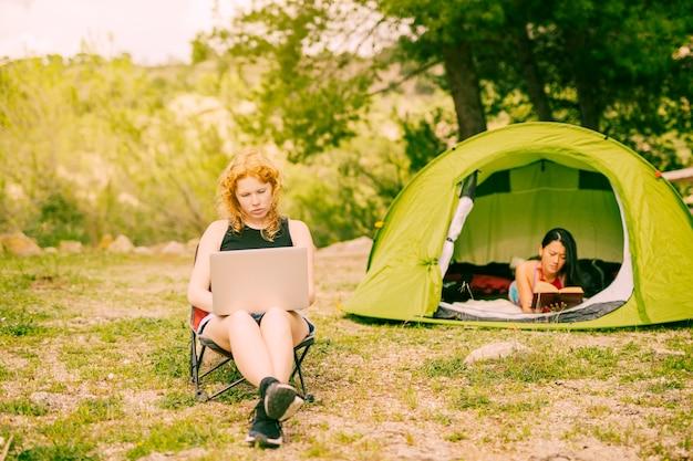 Multiracial women relaxing while hiking Free Photo