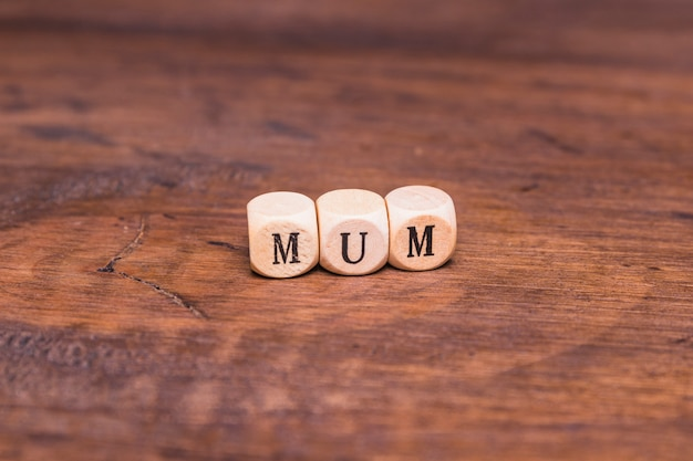 Mum text on wooden table Free Photo
