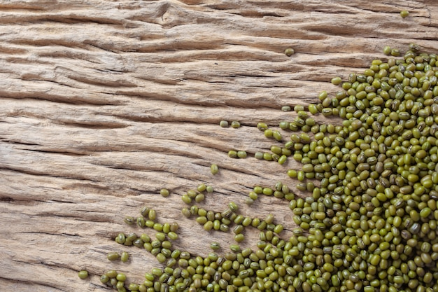 Mung bean seeds on a wooden background in the kitchen Free Photo