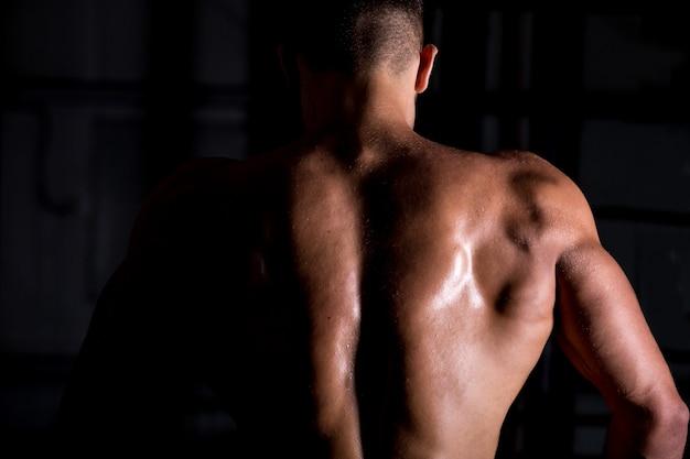 Muscular bodybuilder guy back Free Photo
