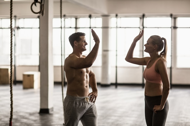 A muscular couple clapping hands Photo   Premium Download