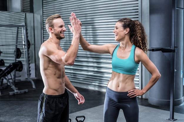 A muscular couple clapping hands Premium Photo