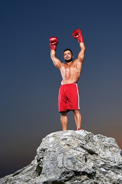 Muscular male boxer posing outdoors Premium Photo