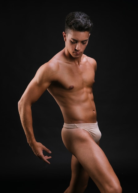 Muscular male in dancing pose Free Photo