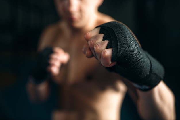 Muscular male person in black bandages Premium Photo