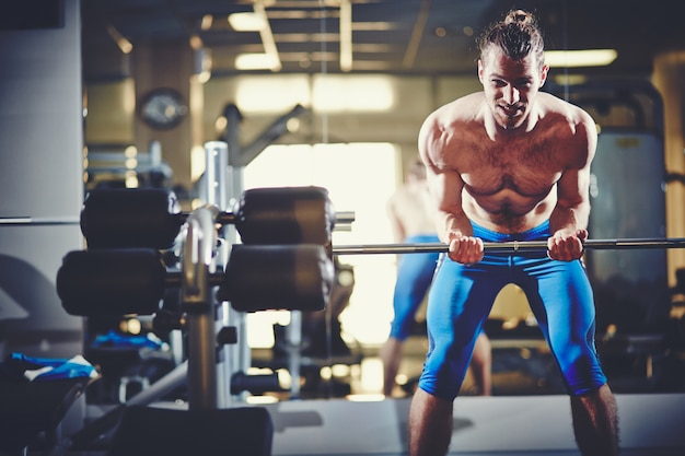 Muscular man with strong arms Free Photo