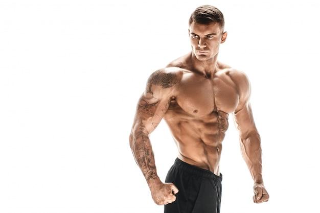 Muscular super high level handsome man posing on white backgroun Premium Photo