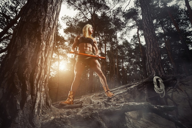 Muscular woman with an ax Free Photo