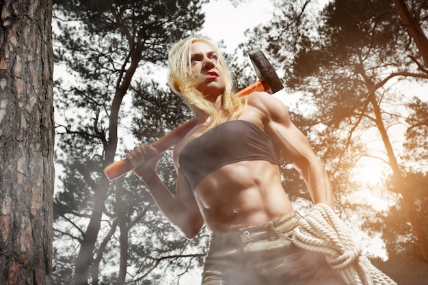 Muscular woman with an axe Free Photo