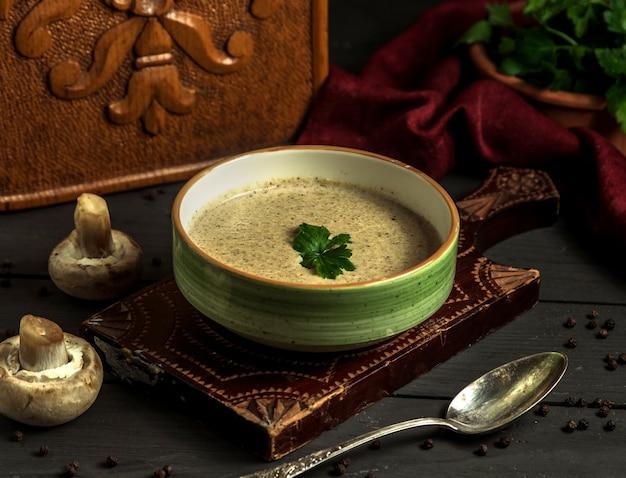Mushroom cream soup on the table Free Photo