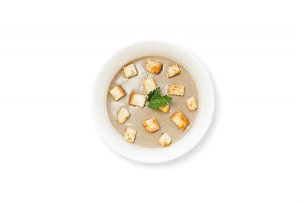 Mushroom cream soup with champignons, cream, onion, garlic isolated on white background. Premium Photo