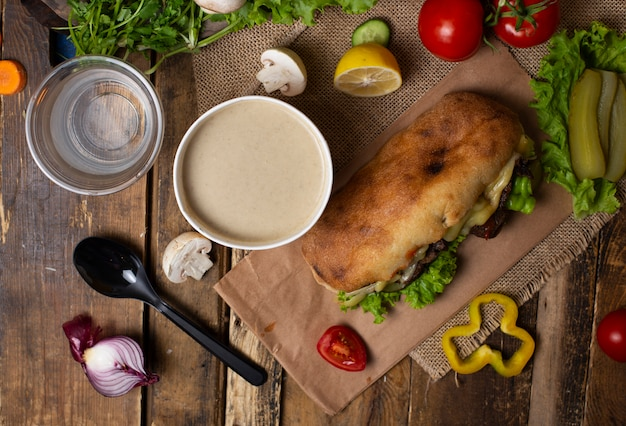 Mushroom cream soup with hommede baguette sandwich takeaway  imagr Free Photo