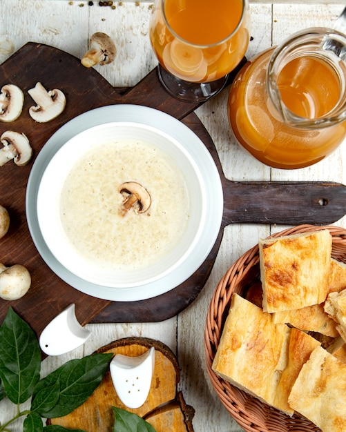 Mushroom cream soup on a wooden board Free Photo