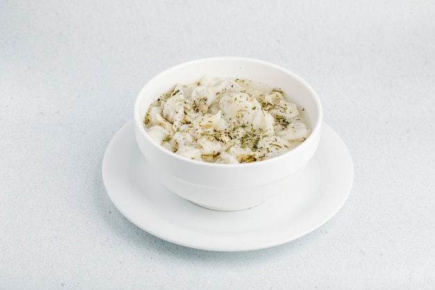 Mushroom creamy soup with spices inside white bowl. Free Photo