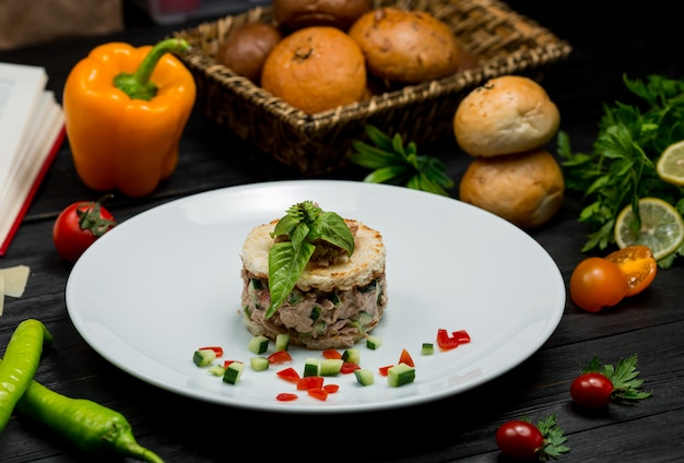 Mushroom risotto inside a white plate with fresh mint leaves on the top Free Photo