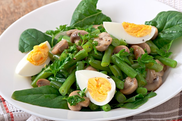 Mushroom salad with green beans and eggs Free Photo