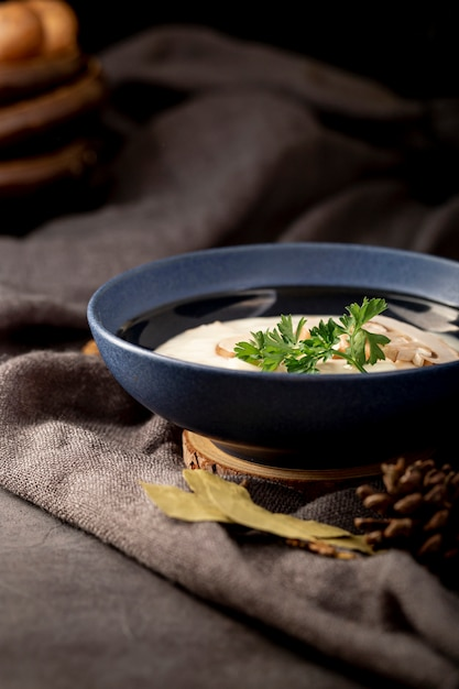 Mushroom soup in a blue jar on a grey cloth Free Photo