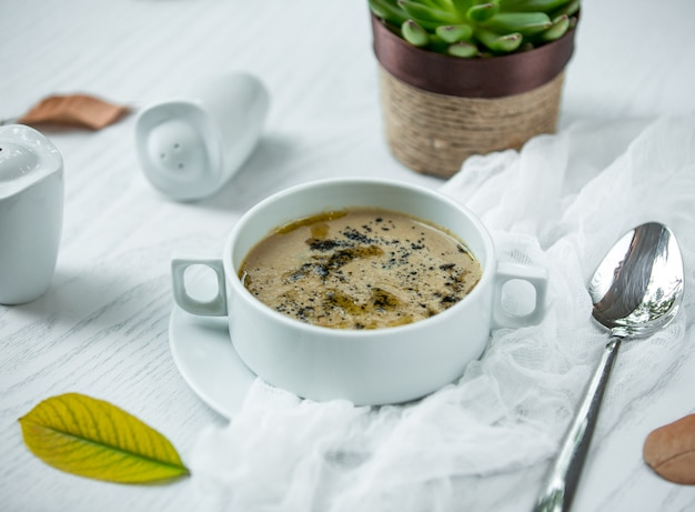 Mushroom soup on the table Free Photo