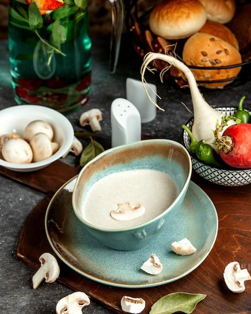 Mushroom soup with bread buns Free Photo