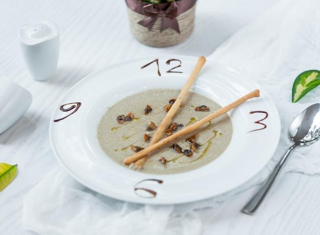 Mushroom soup with bread crutones Free Photo