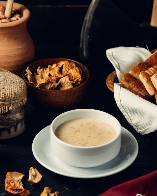 Mushroom soup with bread on the table Free Photo