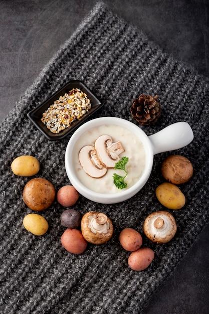Mushroom soup with mushrooms on a grey scarf Free Photo