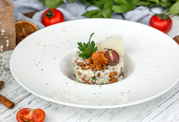 Mushroom truffle risotto garnished with parmesan and parsley Free Photo