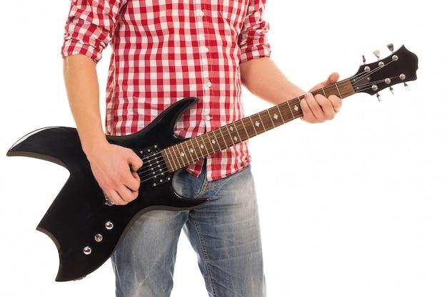 Музыка, крупный план. музыкант с электрогитарой Бесплатные Фотографии