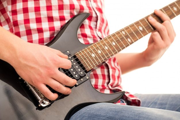 Music, close-up. young musician holding electro guitar Free Photo
