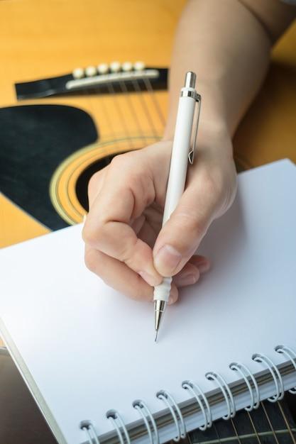 Music composer hand writing songs Premium Photo